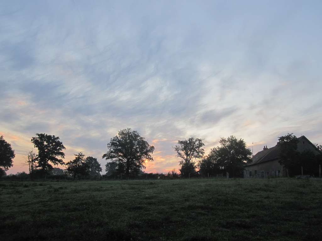 The house and barn at sunrise